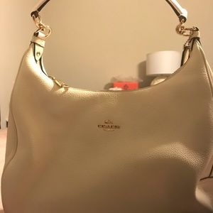 Very good condition cream Coach purse